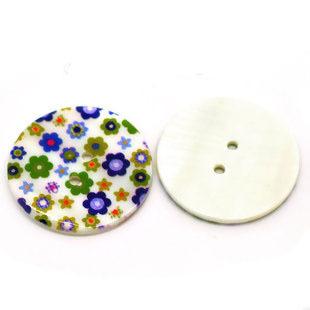 Blommig pärlemorknapp, blå, 25 mm